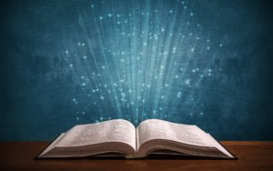 Bible with rays of light in the center - Integrity Syndicate - Love Truth Spirit integritysyndicate.com