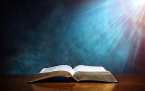An open bible with rays of light by which we know the Apostles Doctrine
